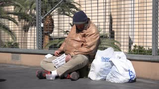 Sleeping homeless man in city streets of Las Vegas 4k