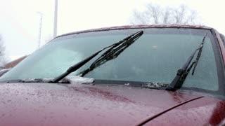 Sleet on the hood of a car