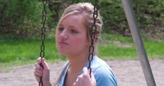 Smiling girl on swing 4k.