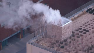 Smoke coming from buildings in downtown of city 4k