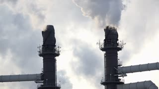 Smokestack from industrial production plant close up 4k