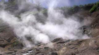 Smoking mountain side hot spring in Yellowstone.