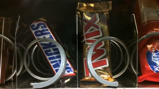 Snicker and Twix coming out of vending machine