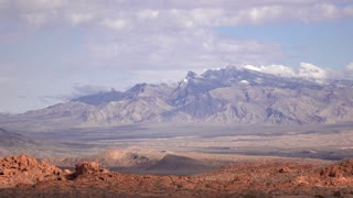 Snow capped mountains seen from Valley of Fire 4k