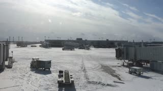 Snow covered airport in Dayton Ohio during winter