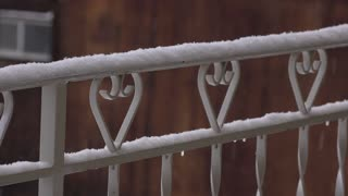 Snow covered railing during winter weather 4k