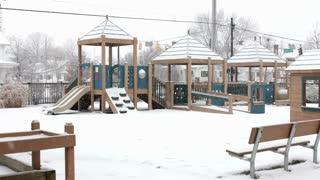 Snow fallling onto children's playground