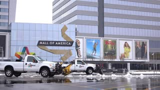 Snow plow trucks in front of Mall of America 4k