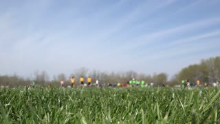Soccer field with focus on grass in foreground 4k
