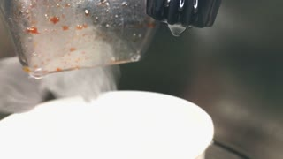 Soda coming out of machine into cup at restaurant 4k