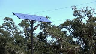 Solar panel on post in parking lot 4k