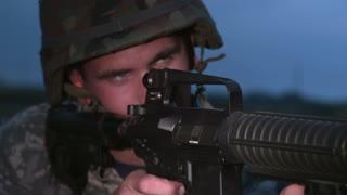 Soldier firing AR15 rifle