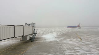 Southwest airline on runway being de-iced