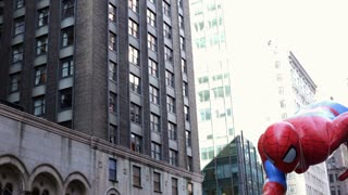 Spiderman balloon in Macy's parade by buildings