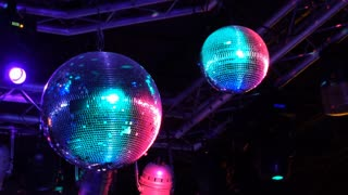 Spinning disco ball in night club 4k