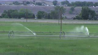 Sprinklers going in farm field