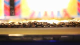 Stacked coins at arcade game