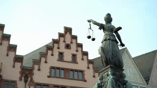 Statue holding scale representing Justice in Roemer area Frankfurt 4k