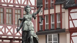 Statue Of Justice At Roemer in downtown Frankfurt Germany 4k
