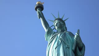Statue of Liberty in bright sunlight on sunny day 4k