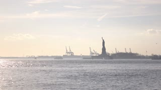 Statue of Liberty in the distance on Liberty Island 4k