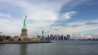 Statue of Liberty seen in Hudson bay with NYC in background 4k