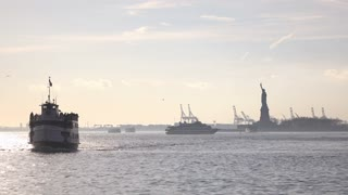 Statue of Liberty tour boat returning to New York City 4k