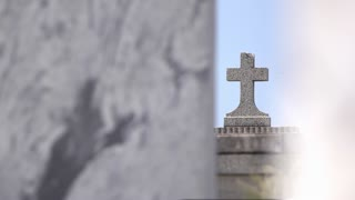 Stone cross headstone at graveyard 4k