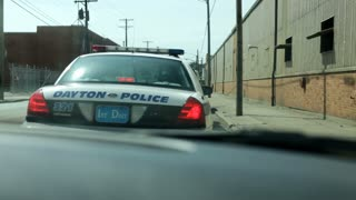 Stopped behind Dayton Police car