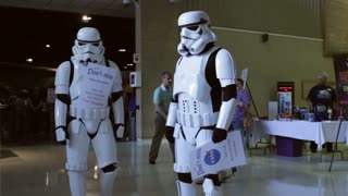 Stormtroopers talking to fans at museum