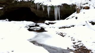 Stream with frozen icicles at the end