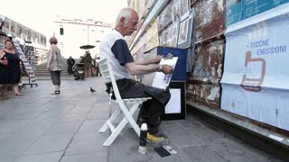 Street artist in Venice Italy painting