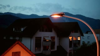 Street light with mountains in background