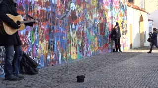 Street performer in Prague at Lennon Wall