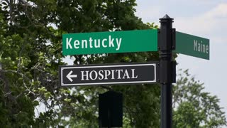 Street sign for Kentucky and Hospital 4k