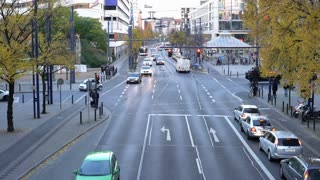 Street traffic at intersection in German town of Offenbach 4k