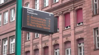 Street train leaving station in downtown Frankfurt Germany 4k