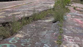 Streets of Centralia with cracks from underground coal fire 4k