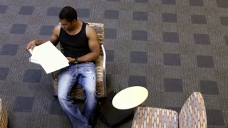 Student studying School notes in Chair