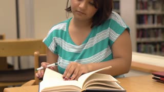 Student underlines important information in book