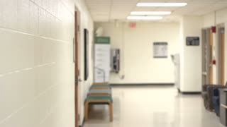 Student walking down hallway