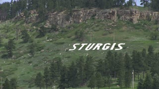 Sturgis lettering in mountain side