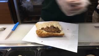 Sub sandwich assembled at restaurant