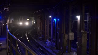 Subway entering metro station in New York City 4k