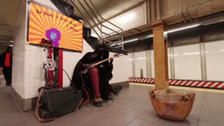Subway stop entertainer playing electric guitar