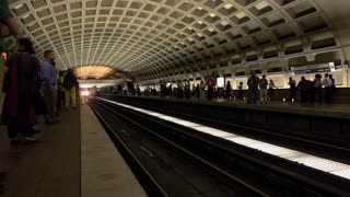 Subway train arriving into station of downtown Washington DC