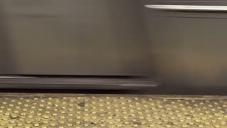 Subway train coming into station quickly