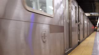 Subway train exiting station into dark tunnel 4k