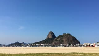Sugarloaf mountain in distance from Botafoga beach