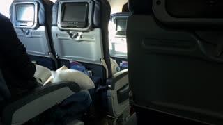 Sun coming through airplane window during flight